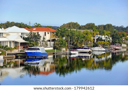 NOOSA, AUSTRALIA - JULY 05, 2009: The canals in beautiful Noosa Waters, Sunshine Coast, Queensland. Where you can tie up your boat on the jetty right next to your house. - stock photo