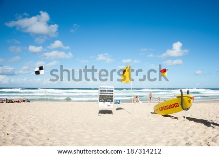 NOOSA, QUEENSLAND, AUSTRALIA - MARCH 11; Noosa Beach, lifeguard station, flags denoting different conditions following a large storm on March 11, 2013 in Noosa Beach, Australia. - stock photo