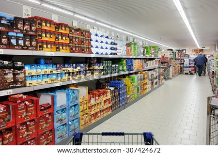 NORDHORN, GERMANY - DECEMBER 23: Shelves with a variety of coffee products in a Aldi supermarket, Aldi is a leading global discount supermarket chain with over 9,000 stores. Taken on December 23, 2014 - stock photo