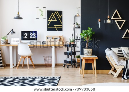 Nordic Natural Interior In Stylish Open Studio For A Freelancer With Sofa, Black  Wall And