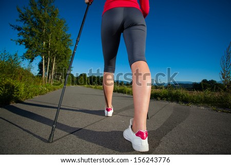 Nordic walking - active people working out outdoor  - stock photo