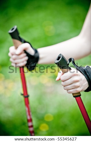 Nordic walking in summer nature - stock photo
