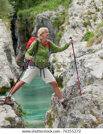 Nordic Walking - woman on mountain trek - stock photo