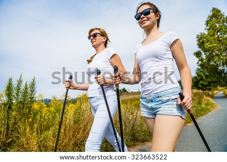 Nordic walking - women working out  - stock photo