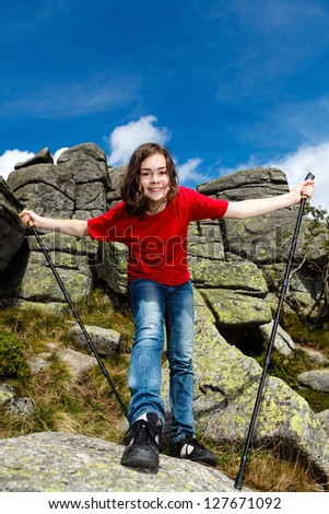 Nordic walking - young woman exercising outdoor - stock photo