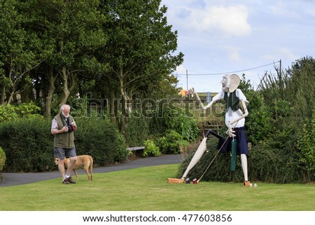 Norland, Halifax, West Yorkshire, UK 2nd September, 2016. Norland Scarecrow Festival 2nd Sept - 5th Sept 2016. man just taken a photo of BFG.