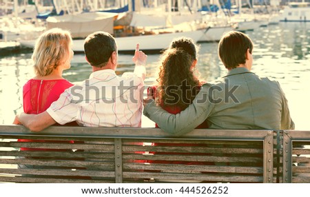 Normal family of four enjoying the sunny spring day together near sea - stock photo
