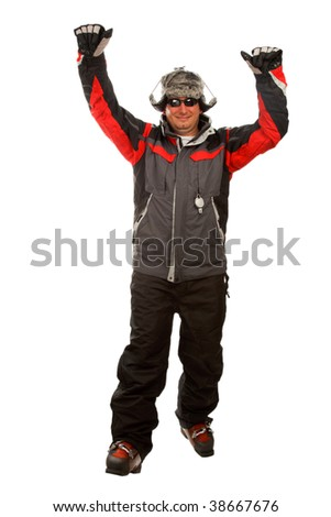 Normal man in a funny winter hat and ski jacket with his hands in the air - stock photo