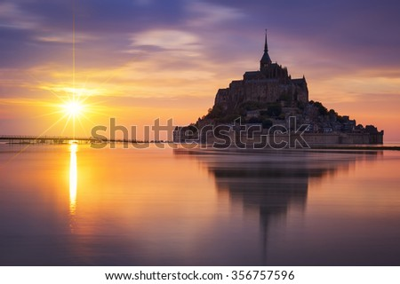 NORMANDY, FRANCE - JUNE 06, 2015: View of famous Mont-Saint-Michel at sunset, France. - stock photo