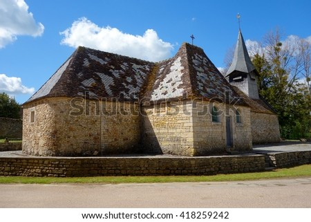 NORMANDY, FRANCE - MAY 5. The 15th Century Chapelle Saint Vigorwas restored by the Japanese artist Kyoji Takubo in 1987 in Normandy, France on May 5th, 2016. - stock photo