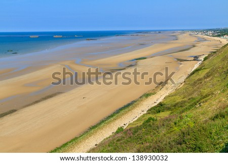 Normandy Landings, remains of artificial port at Arromanches-les-Bains, France - stock photo