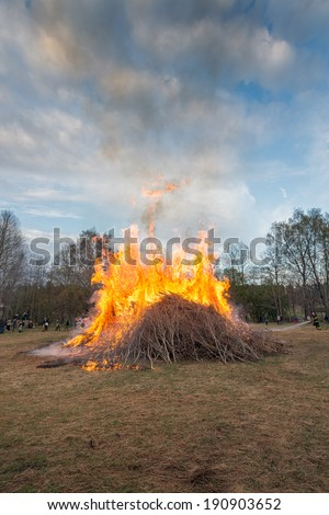 NORRTALJE - APR, 30, 2014: The traditional Valborg fire at Haverodal in April 30, 2014, Norrtalje, Sweden. Tradition in the Nordic countries to welcome the spring. - stock photo