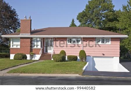 North America sixties era wooden bungalows in suburbia. - stock photo