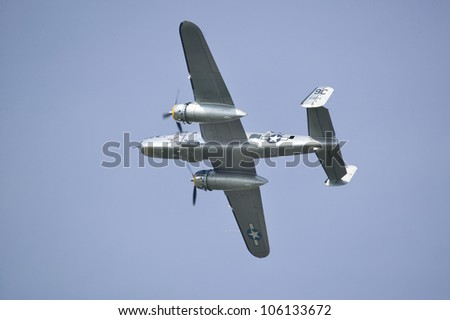North American B-25 Mitchell in flight during World War II reenactment at Mid-Atlantic Air Museum World War II Weekend and Reenactment in Reading, PA held June 18, 2008 - stock photo