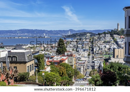North Beach, Treasure Island, East Bay, Oakland, and Coit Tower photographed from the top of famous Lombard street in the Russian Hill and Nob Hill area of San Francisco, California, USA. - stock photo