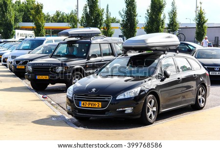 NORTH BRABANT, NETHERLANDS - AUGUST 9, 2014: Motor car Peugeot 508SW at the parking near the intercity highway. - stock photo