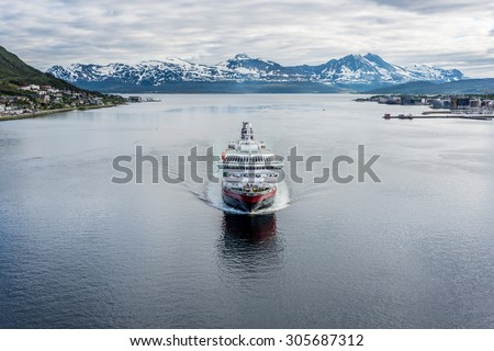 NORTH CAPE, NORWAY - JUNE 30, 2014:  Hurtigruten, a daily passenger and freight shipping service along Norway's western and northern coast between Bergen and Kirkenes. - stock photo