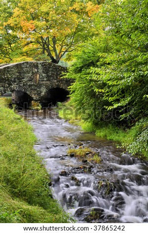 North Carolina Autumn Stone Bridge and Creek Vertical - stock photo