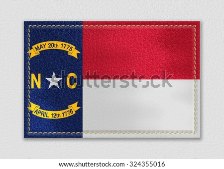 North Carolina flag leather label on a white leather background,vintage style