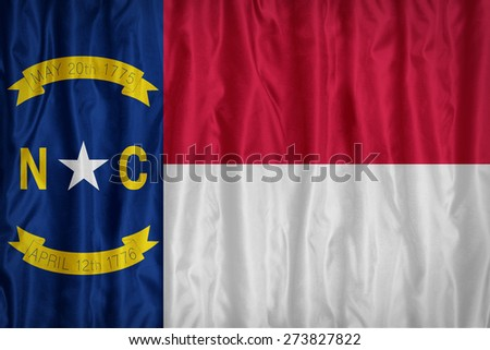North Carolina flag pattern with a peace on fabric texture,retro vintage style