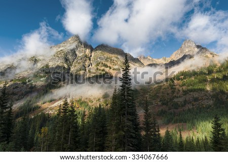 North Cascade Mountains. A lovely autumnal day in the North Cascades seen along the scenic Highway 20, or North Cascades Highway, in eastern Washington state. A popular for rock climbers and hikers. - stock photo