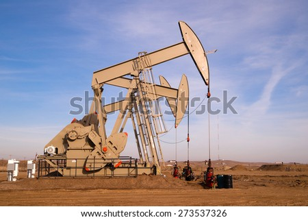 North Dakota Oil Pump Jack Fracking Crude Extraction Machine - stock photo
