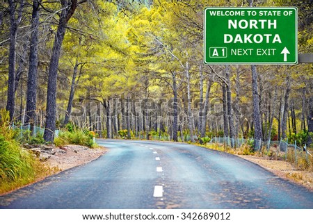 NORTH DAKOTA road sign against clear blue sky - stock photo