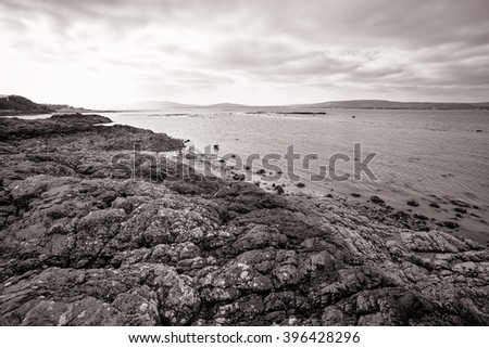 North Down Coastline, Northern Ireland. Rocks, sand and the shore between Belfast and Bangor. - stock photo