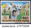 NORTH KOREA - CIRCA 1982: A post stamp printed in North Korea, shows football players, devoted football world championship,Spain, series, circa 1982. - stock photo