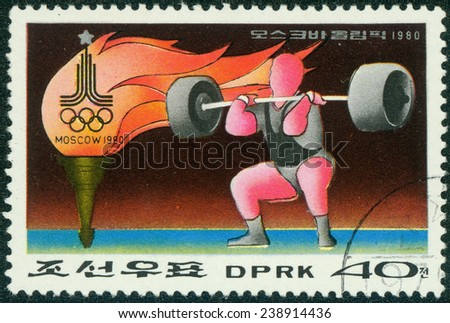 NORTH KOREA - CIRCA 1980: A stamp printed in DPR Korea dedicated to 1980 Moscow Olympics,shows Weight lifting, circa 1980 - stock photo