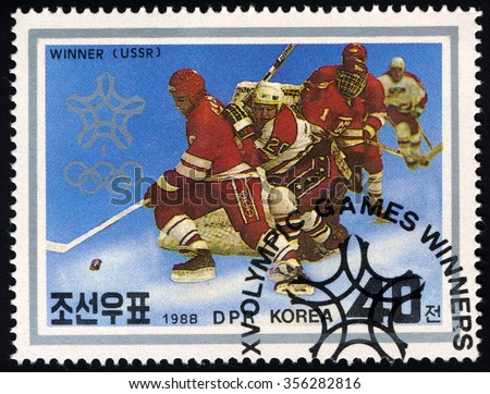 NORTH KOREA - CIRCA 1991: A stamp printed in DPR Korea dedicated to Winter Olympic Games Calgary Medal Winners shows Hockey Team of the USSR, circa 1991 - stock photo