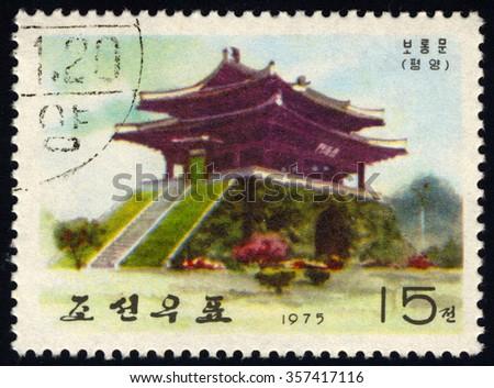 NORTH KOREA - CIRCA 1975: A stamp printed in North Korea dedicated to Taedong Gate shows Ancient Wall-Gates of Pyongyang, circa 1975 - stock photo