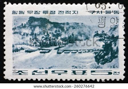 NORTH KOREA - CIRCA 1965: a stamp printed in North Korea shows Kusimuldong, Revolutionary Battle Site, circa 1965 - stock photo