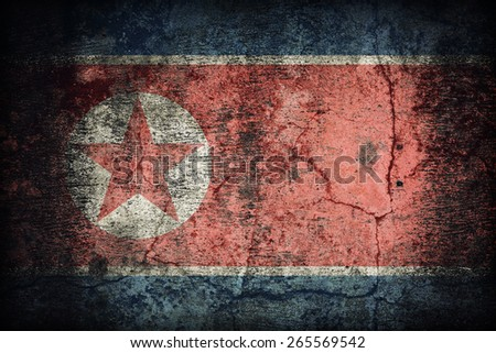 North Korea flag pattern on dirty old concrete wall texture ,retro vintage style - stock photo