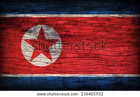 North Korea flag pattern on the wooden board texture ,retro vintage style - stock photo