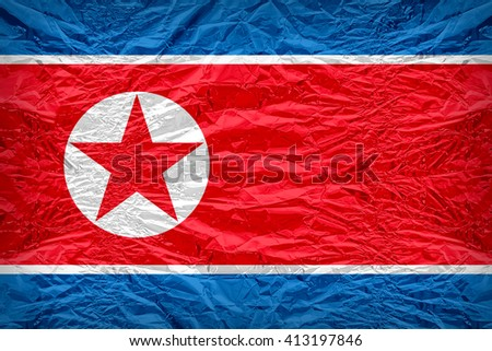 North Korea flag pattern overlay on floyd of candy shell, vintage border style - stock photo