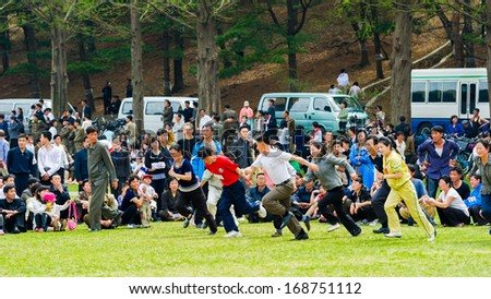 NORTH KOREA - MAY 1, 2012: Korean people participate in the public games due to the celebration of the Internationa Worker's Day in N.Korea, May 1, 2012. May 1 is a national holiday in 80 countries