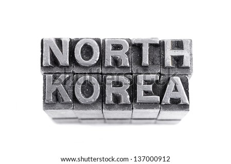 NORTH KOREA sign,  antique metal letter-press type isolated - stock photo