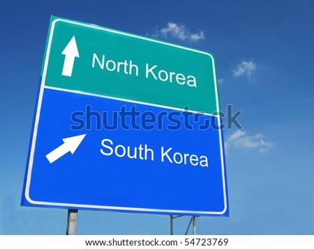 NORTH KOREA -- SOUTH KOREA road sign - stock photo