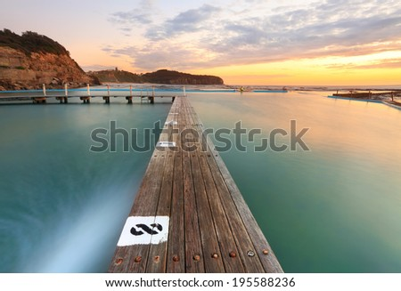 North Narrabeen Tidal Pool from Lane 8, Narrabeen Beach Sydney, Australia, at sunrise. Focus to foreground - stock photo