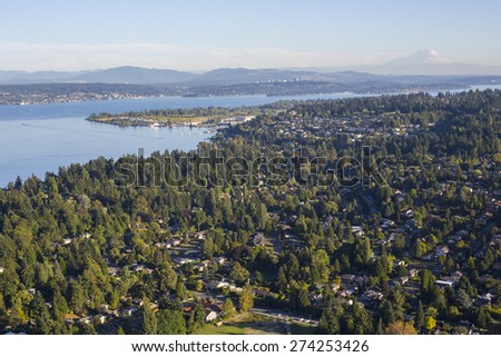 North Seattle Aerial View facing Mt Rainier over trees and Lake Washington - stock photo