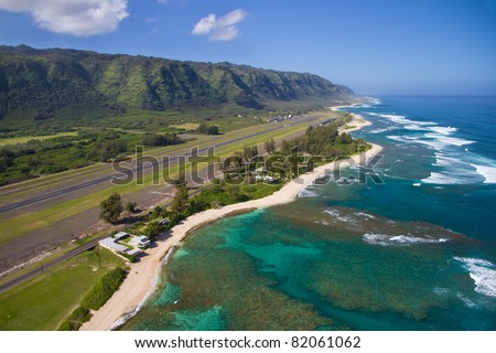 North Shore aerial of Oahu, Hawaii - near Dillingham Airfield - Makuleia Beach in foreground, Hidden Beach and Kaena Point in distance - stock photo