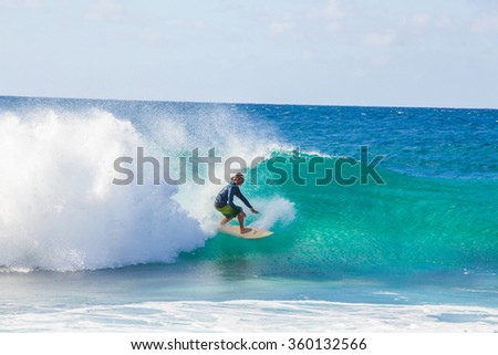 North Shore Oahu, Hawaii 10/20/2015 Surfer Rides Wave