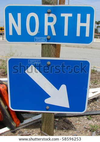 North sign on freeway with arrow