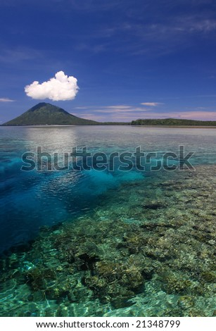North Sulawesi indonesia looking down at clear water and coral reefs