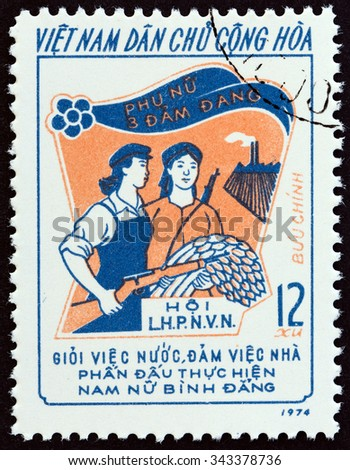 "NORTH VIETNAM - CIRCA 1974: A stamp printed in North Vietnam from the ""Three Responsibilities Women Movement "" issue shows Armed Worker and Peasant, circa 1974.  - stock photo"
