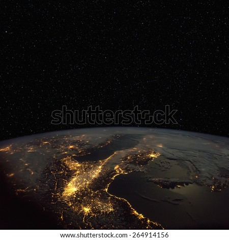 Northern  Italy at night from space, with stars above. Elements of this image furnished by NASA.  - stock photo