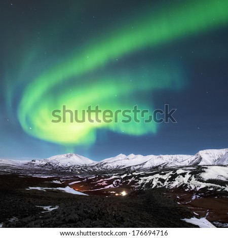 Northern lights above fjords in Iceland - stock photo