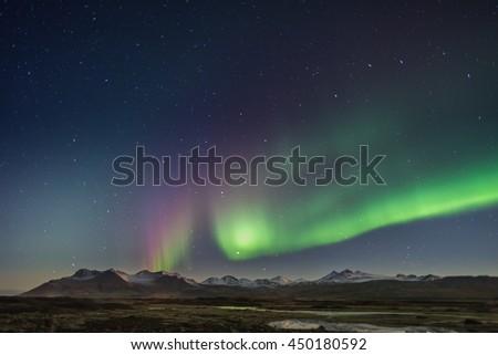 Northern Lights - Aurora borealis over Snaefellsnes peninsula in Iceland - stock photo