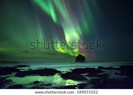 Northern Lights in Iceland, shot by the sea. - stock photo